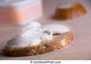 Slice of bread with cheese cream