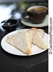 slice of bread with coffee