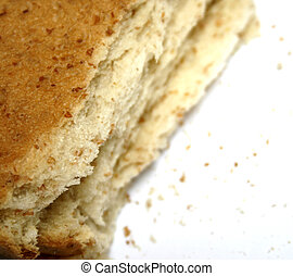 slice of bread with crumbs; isolated; white background