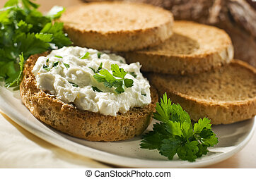 slice of bread with curd and parsley close up