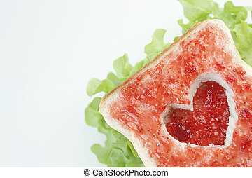Slice of bread with fruit jam heart shape