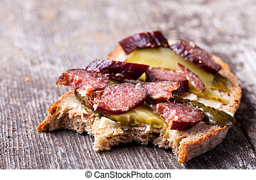 slice of bread with sausage