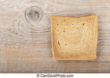 slice of breadon a wooden background