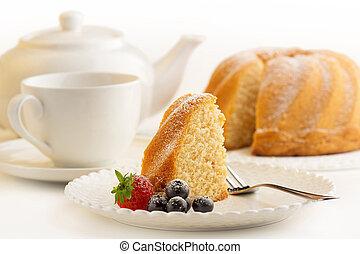 slice of sponge cake and white porcelain