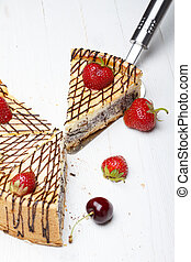 Slice of cheesecake with strawberry on cake lifter
