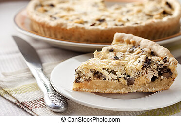 Slice of chicken tart with mushrooms and cheese