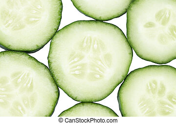 Slice of cucumber isolated on white background, top view