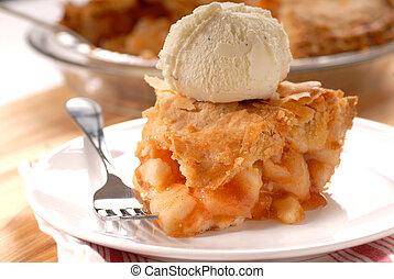 Slice of deep dish apple pie with vanilla ice cream