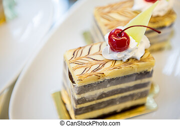 Slice of delicious cake with fresh berry