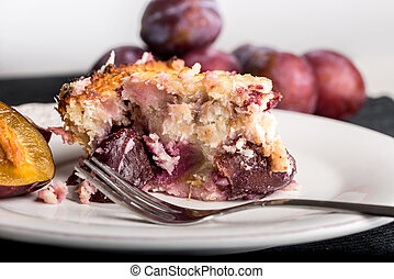 Slice of delicious home baked plum pie
