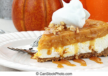 Slice of Double Layer No Bake Pumpkin Pie made with pumpkin, vanilla pudding, cream cheese, and whipped cream.