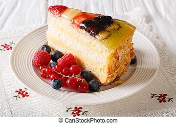 Slice of fruit jelly cake closeup on a table. Horizontal