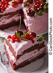 Slice of homemade berry cake on a plate closeup. vertical