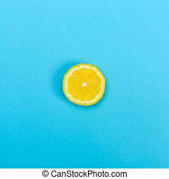 Slice of lemon on a blue background