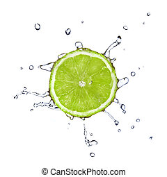 Slice of lime with water drops isolated on white