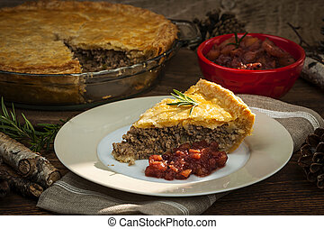 Slice of meat pie Tourtiere - Slice of traditional pork meat...