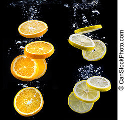 slice of orange and lemon in the water with bubbles, on...