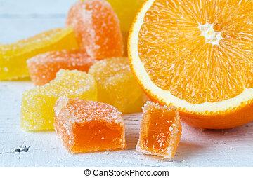 Slice of orange on wooden table