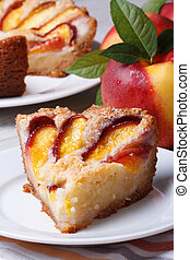 Slice of peach pie on a white plate vertical