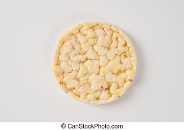 slice of puffed rice bread on white background