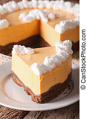 slice of pumpkin cheesecake close-up on a plate. vertical