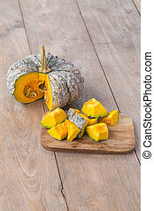 Slice of pumpkin on a wooden table