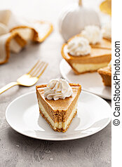 Slice of pumpkin pie with a cheesecake layer