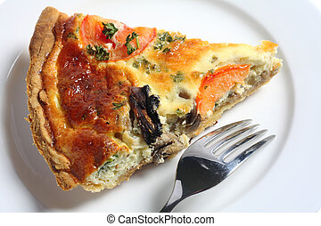 A slice of homemade mushroom quiche on a white plate with a fork, viewed from above