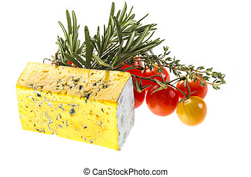 Slice of Roquefort cheese with tomato and herbs