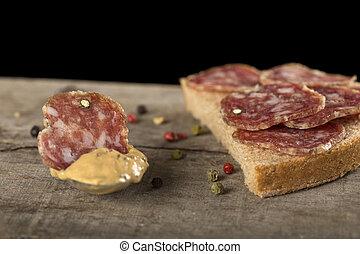 Slice of salami in mustard sauce