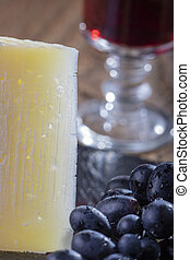 slice of spanish manchego cheese with wine