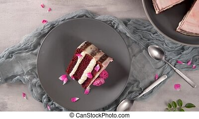 Slice of strawberry cake, strawberry sponge cake with fresh strawberries and sour cream on a pink background.