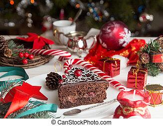 Slice of sweet chocolate cake for Christmas Eve.