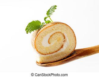 Slice of sweet roll on a wooden spoon