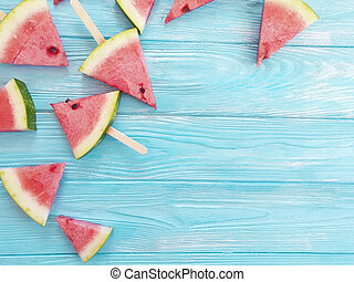 slice of watermelon on a wooden background
