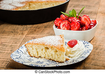 Slice of yellow cake with strawberries