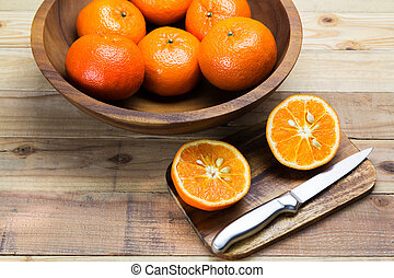 Slice oranges on wooden background.