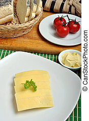 slice poppy seed bread with cheese on a plate