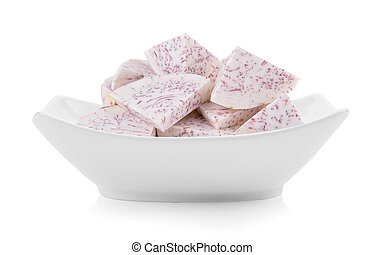 slice taro root in a bowl on white background