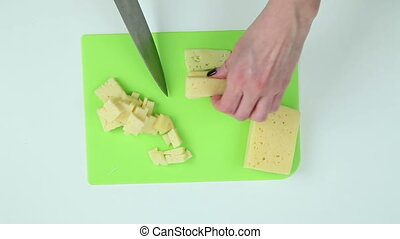 Slice the cheese into pieces