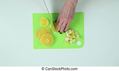 Slice the oranges with a knife