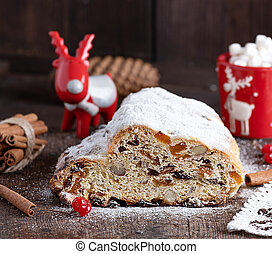 slice traditional European cake Stollen with nuts and candied fruit