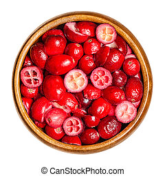 Sliced and dried cranberries in a wooden bowl. Edible and ...