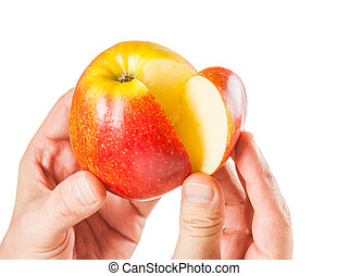 sliced ??apple in the hands