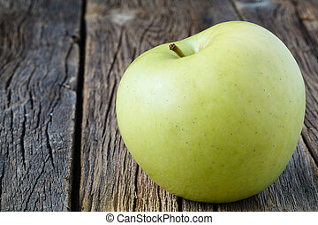 Sliced apple on rustic wooden table, close up view