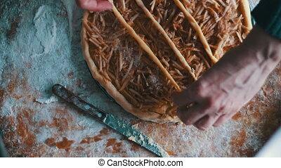 Sliced apples on cake batter in baking pan