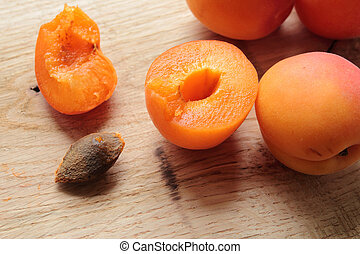 Sliced apricot fruit on a wooden table