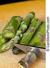 Sliced Asparagus into pieces with a knife