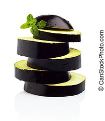 Sliced aubergine, eggplant arranged stack, pile isolated white