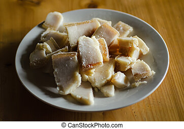Sliced bacon - Sliced pork fat lard tallow axunge on a dish...